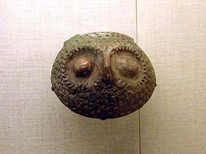 Henan - a Yangshao pot that resembles an owl face.
