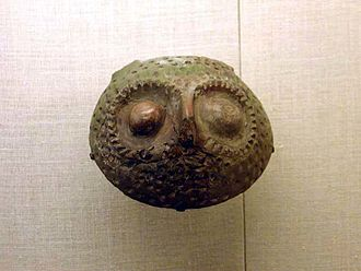 Henan - a Yangshao pot that resembles an owl face.