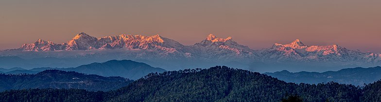 Panorama showing Alpenglow on Himalayan Peaks.jpg