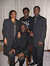 A Kenyan Christian pastor with family.