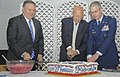 Pat Roberts, Mike Pompeo, and Joel Jackson cut the cake during the celebration of the 20th Anniversary of 22nd ARW.jpg