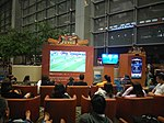 People watching 2018 FIFA World Cup at Singapore Changi Airport (1).jpg