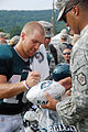 Philadelphia Eagles wide receiver Chad Hall signs an autograph for Sgt. 1st Class Manuel Roman.jpg
