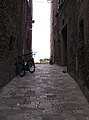 Pienza Tiny Street with Bicycles - panoramio.jpg