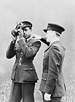 Pilot Officer J H Smythe of Sierra Leone, a newly-qualified navigator, being instructed in the use of the sextant by an instructor at No. 11 Operational Training Unit, Westcott in Buckinghamshire, 1 August 1943. CH10740.jpg
