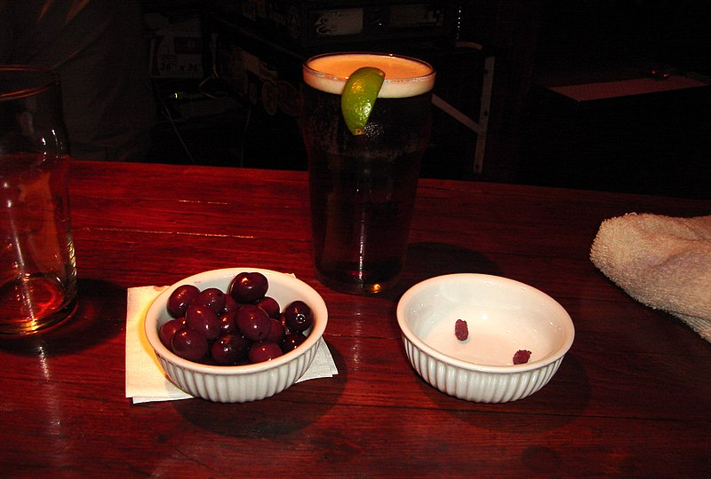 Pint of beer and black olives.jpg