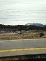 Platform of Kashiwabara Station and Mount Ibukiyama.jpg