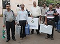 Polling officials carrying the Electronic Voting Machines (EVM's) and other necessary belongings for use in the General Elections-2014, at the distribution centre, at Bhubaneswar, Odisha on April 16, 2014.jpg