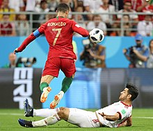 brand new 4dbd2 add5b Ronaldo evades an Iran defender in the group stage of the 2018 FIFA World  Cup in Russia