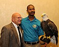 Posing for picture with Bald Eagle. (10594940176).jpg