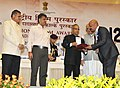 Pranab Mukherjee presenting the Rajat Kamal Award for Best Film on Family Values After Glow (English & Gujarati) and Best Short Fiction Film Kaatal (Marathi) in Non Feature Film Section to the Producer.jpg