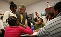 President George W. Bush spends time with students at the Waldo C. Falkener Elementary School.jpg