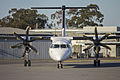 QantasLink (VH-QOS) Bombardier DHC-8-402Q taxiing to bay 3 at Wagga Wagga Airport.jpg