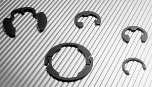 Retaining ring - Radially installed e-clips and retaining rings