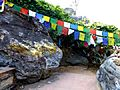 Rajgir - 039 Cave and Flags (9244913028).jpg