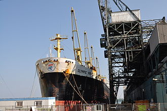 Redpath Sugar Refinery - Sugar shed and raw sugar shipping vessel