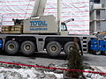 Removing the big boom crane from atop the almost finished reconstruction of the old National Hotel, 2015 03 07 (14) (16137199524).jpg