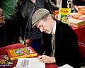 Robert Crumb signing a copy of Genesis in 2012.jpg