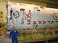 Ron Garan in Front of Soyuz Booster.jpg