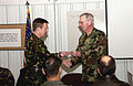 Royal Air Force Wing Commander David M. Beckwith is presented a specially engraved bullet by US Army Major General Don C. Morrow, Adjutant General for the State of Arkansas.jpg