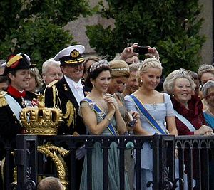 Mary, Crown Princess of Denmark - HRH the Crown Princess of Denmark attends the wedding of the Crown Princess of Sweden. She is pictured here surrounded by (left to right): Crown Prince Frederik of Denmark; Willem-Alexander, King of The Netherlands; Queen Máxima of the Netherlands; Crown Princess of Norway; and Beatrix of the Netherlands, former queen regnant of The Netherlands.