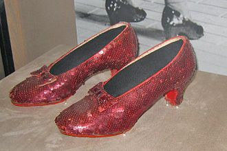 Adrian (costume designer) - The original Adrian-designed ruby slippers used in The Wizard of Oz; now on display at the Smithsonian.