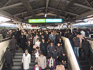 "Salaryman - ""Sararīman"" take their train daily to work in the Tokyo metropolitan area."
