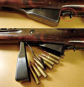 SKS - SKS with the magazine closed (top) and open. The magazine release is circled.