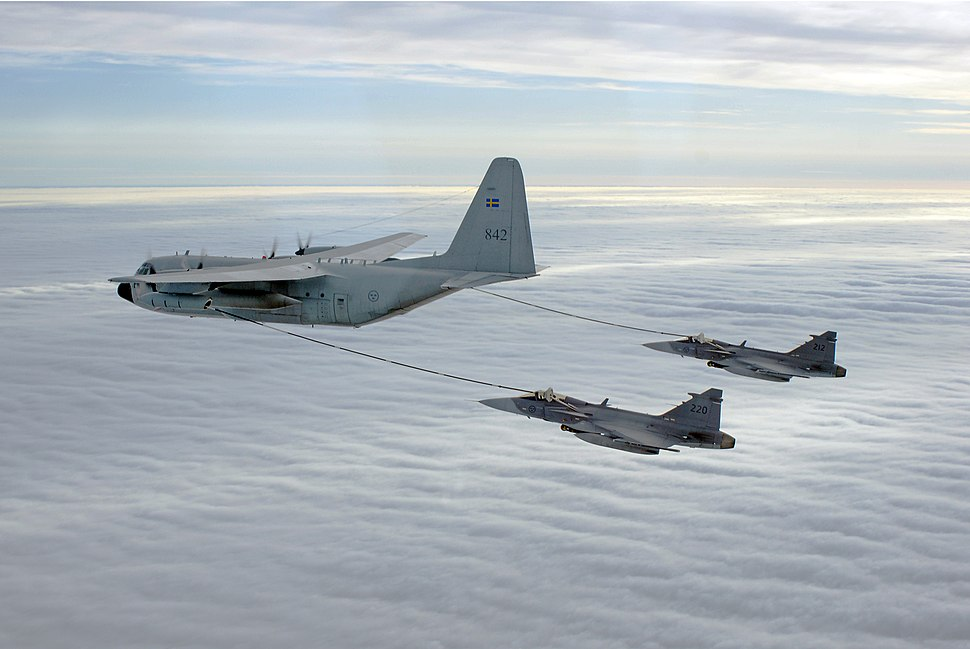 Saab JAS-39 of the Swedish Air Force undergoing inflight refuelling from a TP 84 Hercules (7322199176)