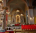 Saint Josaphat Catholic Church (Detroit, MI) - St. Joseph altar, with Sts. Peter & Paul, and the Child of Prague.jpg