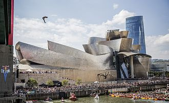 Red Bull Cliff Diving World Series - A person dives from the 27.5 meter platform on La Salve bridge.