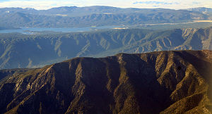 Santa Ana River - The Transverse Ranges were formed by uplift along the San Andreas Fault. Santa Ana Canyon is between the first and second ridges and Big Bear Lake is in the background.