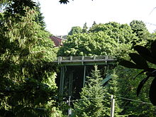 A steel bridge surrounded by trees