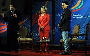 Arnab Goswami - Goswami with Hillary Clinton (centre) and Aamir Khan (right) at an event in Mumbai, in July 2009