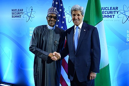 Buhari with U.S. Secretary of State John Kerry, 31 March 2016 Secretary Kerry Poses for a Photo With Nigerian President Buhari at the 2016 Nuclear Security Summit in Washington (26064371402).jpg
