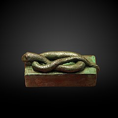 Serpent sarcophagus with knotted snake