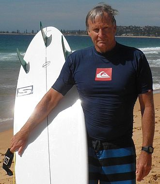 Simon Anderson - Simon Anderson holds a surfboard at North Narrabeen Beach, NSW, Australia.