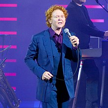 Colour photograph of Simply Red performing live onstage in 2009.