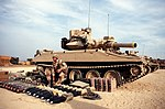 Soldier of 3rd Battalion, 73rd Armor laying out equipment for an M551A1 Sheridan before life fire exercise during Operation Desert Shield DA-ST-92-07502.jpg