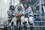Soyuz MS-15 crew in front of the Soyuz spacecraft simulator.jpg