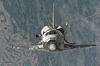 STS-114 - Discovery photographed from the International Space Station as it performs the first ever rendezvous pitch maneuver.