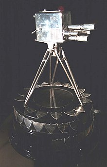 The trophy for the main award – a silver four-turret lens camera.