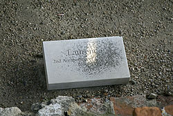 "Stone set on the ground inscribed with ""Laurence, second Archbishop of Canterbury 605–619, d. 619"""
