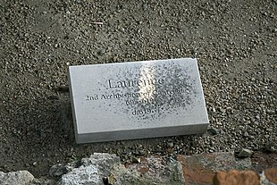 """Stone set on the ground inscribed with """"Laurence, second Archbishop of Canterbury 605–619, d. 619"""""""