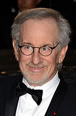 Headshot of a bearded and bespectacled Jewish male wearing a black tuxedo.