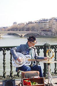 Street musician in Paris 2010.jpg