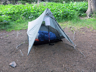 Ultralight backpacking - Many ultralight backpackers use a tarp tent system where the trekking pole serves as the structure for the tent.