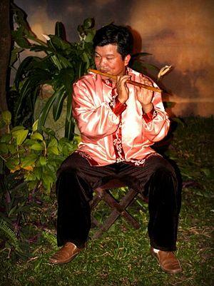Sáo - player of Sáo trúc (Vietnamese bamboo flute)