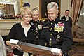 The 35th Commandant of the Marine Corps, Gen. James F. Amos, right, and Marine Corps First Lady Bonnie Amos, left, participate in a gift exchange with Gen. George J. Flynn, center, at the Home of the Commandants 130509-M-LU710-109.jpg