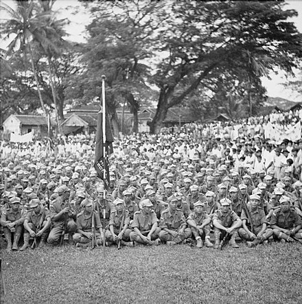 Thousands of MPAJA guerrillas during their disbandment ceremony in Kuala Lumpur after the end of war in 1945. The British Reoccupation of Malaya SE5883.jpg